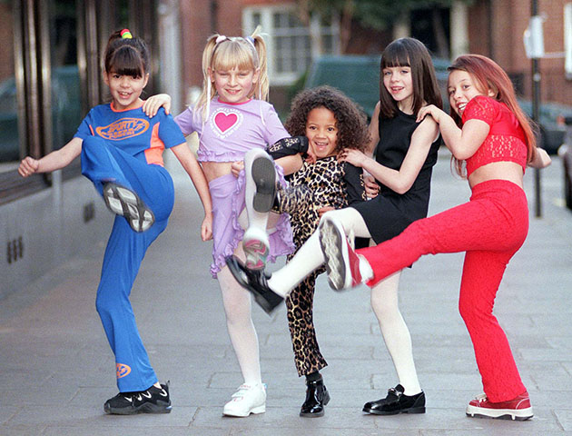 Top London store Harrods launch their new collection of children's wear styled on the Spice Girls today (Friday). Spice Gear, aimed at 4-14 year-old girls, is modelled by mini Spice Girls (l to r) Sporty Spice, Miriam Ziriat (aged 9); Baby Spice, Abigail Fullerton (8); Scary Spice, Tanesia Price (5); Posh Spice, Lucy Potter (7); and Ginger Spice, Rebecca Young (8). Photo by Ben Curtis/PA